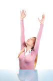 Attractive young woman reaching up Stock Photos