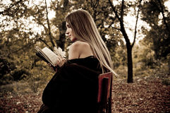Attractive Young Woman Reading Book Royalty Free Stock Image