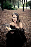 Attractive young woman reading book Royalty Free Stock Images