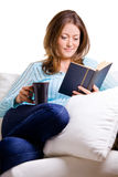 Attractive Young Woman Reading A Book Stock Images