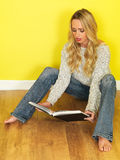 Attractive Young Woman Reading a Book Royalty Free Stock Image
