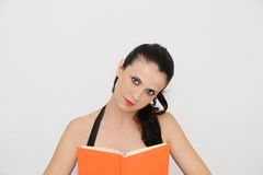 Attractive young woman reading book Stock Photography