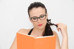 Attractive young woman reading book Stock Images