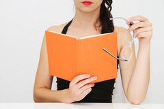 Attractive young woman reading book Stock Photos