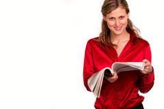 Attractive young woman reading magazine Royalty Free Stock Photo