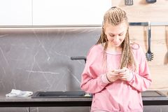 Attractive young woman reading a text message royalty free stock photos