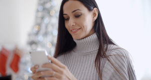 Attractive young woman reading a text message Royalty Free Stock Images