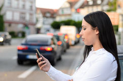 Attractive young woman reading a text message Stock Image