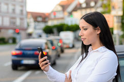 Attractive young woman reading a text message Royalty Free Stock Photo