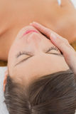 Attractive young woman receiving facial massage at spa center Stock Photography