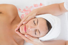 Attractive young woman receiving facial massage at spa center Royalty Free Stock Images