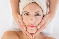 Attractive young woman receiving facial massage at spa center Royalty Free Stock Photos