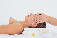 Attractive young woman receiving head massage at spa center Stock Image