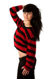 Attractive young woman in red and black sweater isolated Royalty Free Stock Photography