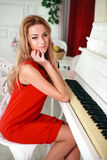 The attractive young woman in a red dress Stock Images