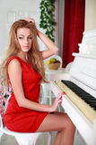 The attractive young woman in a red dress royalty free stock photos