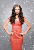 Attractive, young woman in red dress wearing golden luxury headb Stock Photo