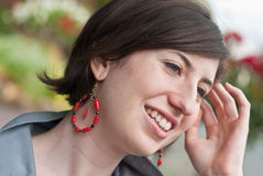 Attractive young woman with red earrings Royalty Free Stock Photos
