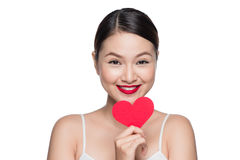 Attractive young woman with red heart. Valentine`s day art portr Royalty Free Stock Photography
