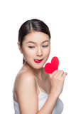 Attractive young woman with red heart. Valentine`s day art portr Royalty Free Stock Photo