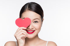 Attractive young woman with red heart. Valentine`s day art portr Stock Image