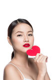 Attractive young woman with red heart. Valentine`s day art portr Stock Photos