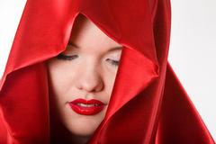 Attractive young woman in red hood Stock Image