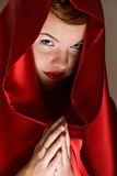 Attractive young woman in red hood Royalty Free Stock Photography