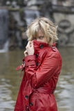 Attractive young woman with red leather jacket Royalty Free Stock Photo