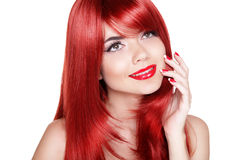 Attractive young woman with red long curly hairs. Happy smiling Stock Image