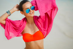 Attractive young woman with red pareo on the beach Royalty Free Stock Photos