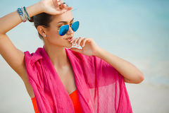 Attractive young woman with red pareo on the beach Stock Image