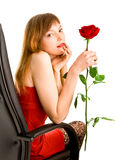 Attractive young woman with red rose Royalty Free Stock Images