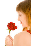 Attractive young woman with red rose. Isolated on white Stock Photos