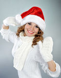 Attractive young woman in red Santa hat Royalty Free Stock Image