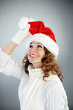 Attractive young woman in red Santa hat Stock Photography