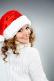 Attractive young woman in red Santa hat Royalty Free Stock Photography