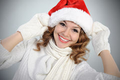 Attractive young woman in red Santa hat Stock Photos