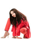 Attractive young woman in red suit. Isolated Royalty Free Stock Photos