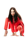 Attractive young woman in red suit. Isolated Royalty Free Stock Photo