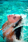Water pleasure. Attractive young woman refresh in pool under the small waterfall Stock Photos