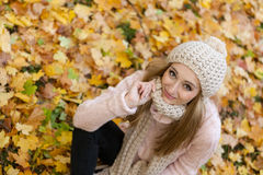 Attractive young woman relaxing in atumn park outdoor Royalty Free Stock Photo
