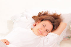 Attractive young woman relaxing in bed Royalty Free Stock Image