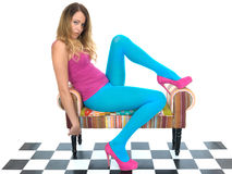 Attractive Young Woman Relaxing in Blue Tights Stock Photo
