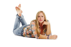 Attractive young woman relaxing on the floor Royalty Free Stock Photography