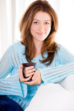 Attractive Young Woman Relaxing With Her Coffee Stock Photo
