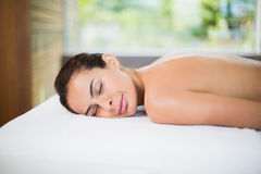 Attractive young woman relaxing on massage table Royalty Free Stock Image