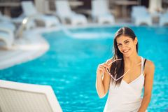 Attractive young woman relaxing at nluxury vacation resort pool.Enjoying summer.Vacation mood.Girl at travel spa resort pool.Flirt stock photography
