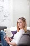 Attractive young woman relaxing reading Stock Photos