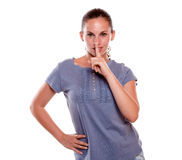 Attractive young woman requesting to you silence Stock Images